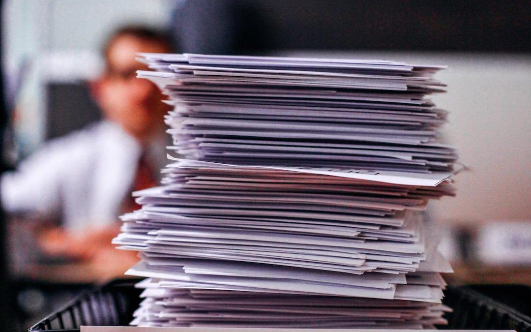 """Photo of a pile of papers and a label that says """"Accepted"""""""